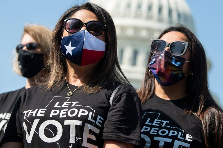 Texas state Reps. Mary Ann Perez, center, and Christina Morales, right, attend a news conference with members of the Texas Ho