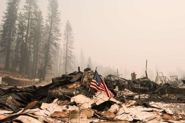 An American flag rests on rubble of the Greenville Fire Department destroyed by the Dixie Fire on August 9, 2021 in Greenville, California. (Photo by David Odisho/Getty Images)