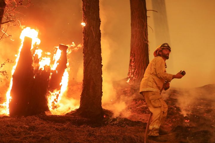 A firefighter continues to hold the line of the Dixie Fire near Taylorsville, California, U.S., August 10, 2021.