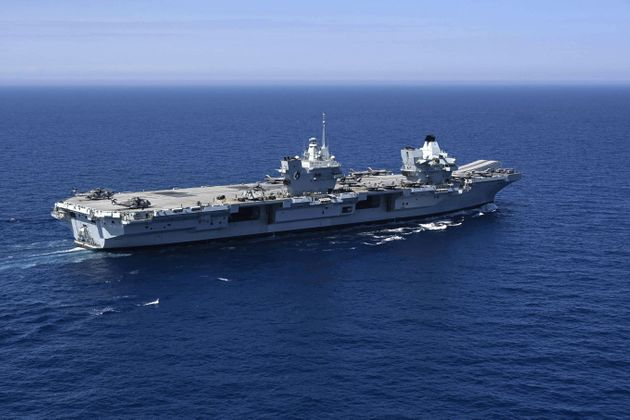 The Royal Navy's aircraft carrier HMS Queen Elizabeth sails during the Navy exercise