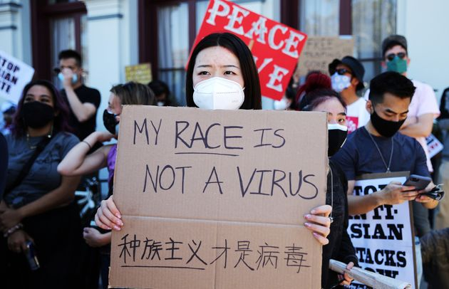 People demonstrate against anti-Asian violence and racism on March 27, 2021, in Los Angeles.
