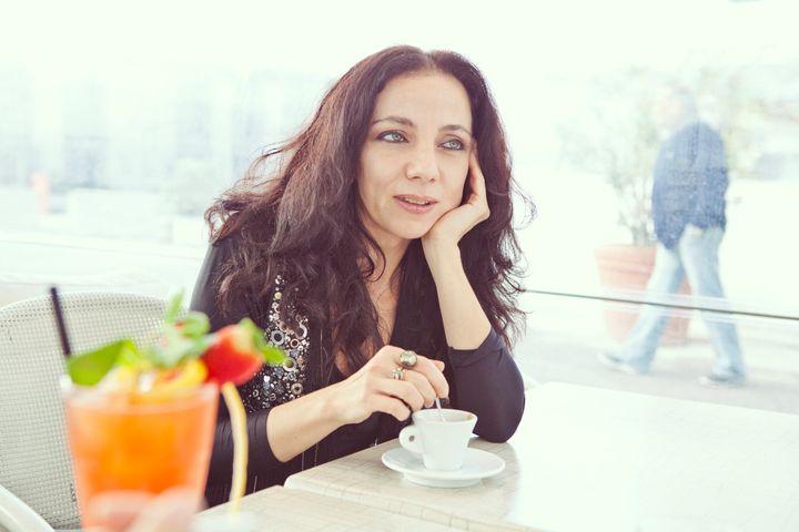 Elegant woman drinking coffee.