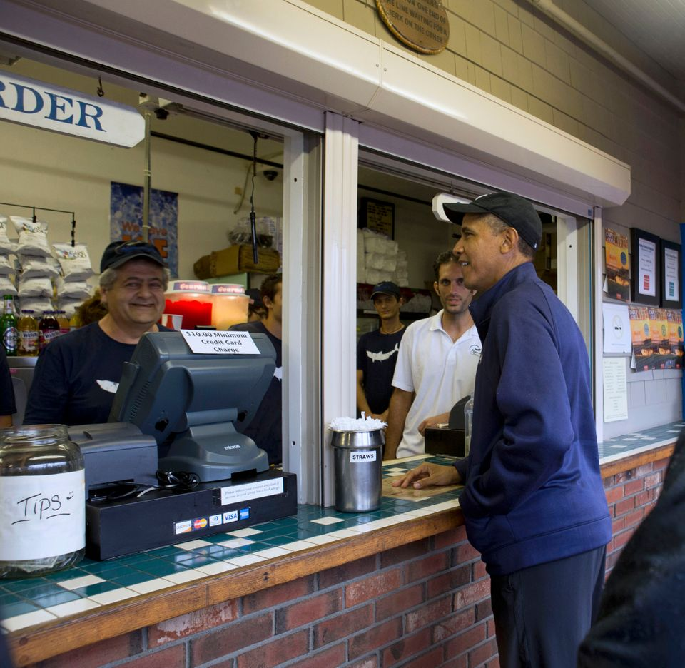 FILE - In this Aug. 13, 2013 file photo, President Barack Obama orders lunch at Nancy's restaurant in Oak Bluffs, Mass., on t