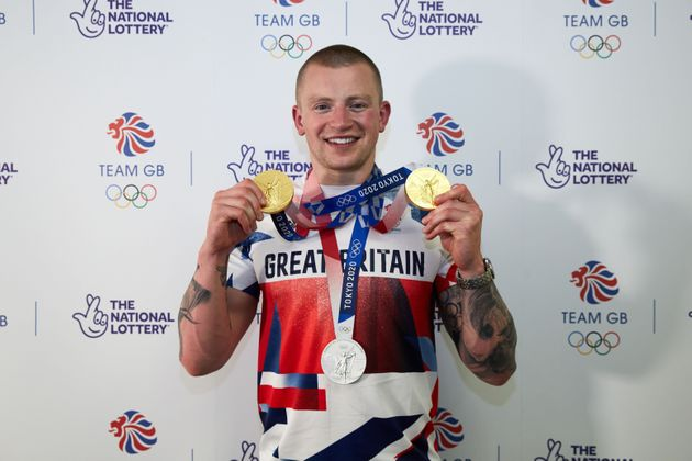 Adam Peaty poses with his medals from the Tokyo 2020