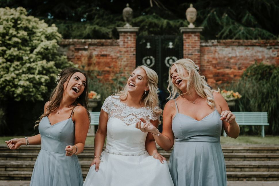 Francesca Jones dancing with her sisters at her wedding in Irnham, Lincolnshire, in July 2017.