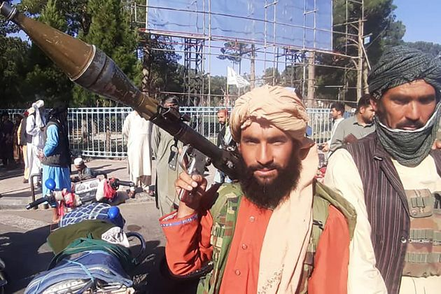 TOPSHOT - In this picture taken on August 13, 2021, a Taliban fighter holds a rocket-propelled grenade...