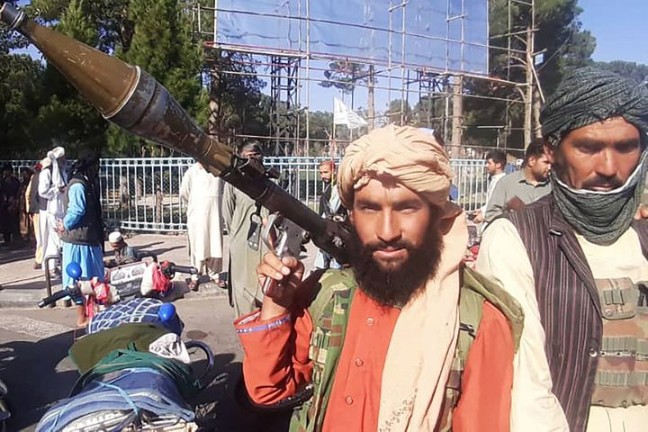 A Taliban fighter holds a rocket-propelled grenadea long the roadside in Herat, Afghanistan's third biggest city, on Aug. 12.