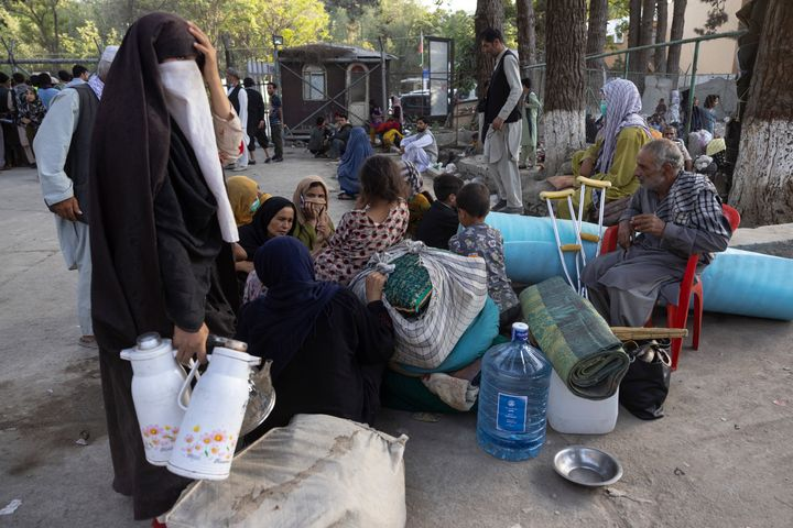 Displaced Afghans from the northern provinces are evacuated from a makeshift camp to various mosques and schools.