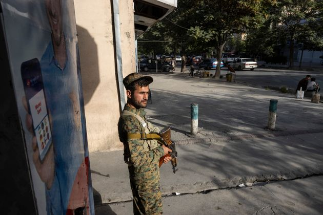 KABUL, AFGANISTAN - AUGUST 13 : Kabul police secure areas in the central part of the city on August 13, 2021 in Kabul, Afghanistan. Tensions are high as the Taliban advance on the capital city after taking Herat and the country's second largest city Kandahar. (Photo by Paula Bronstein /Getty Images)