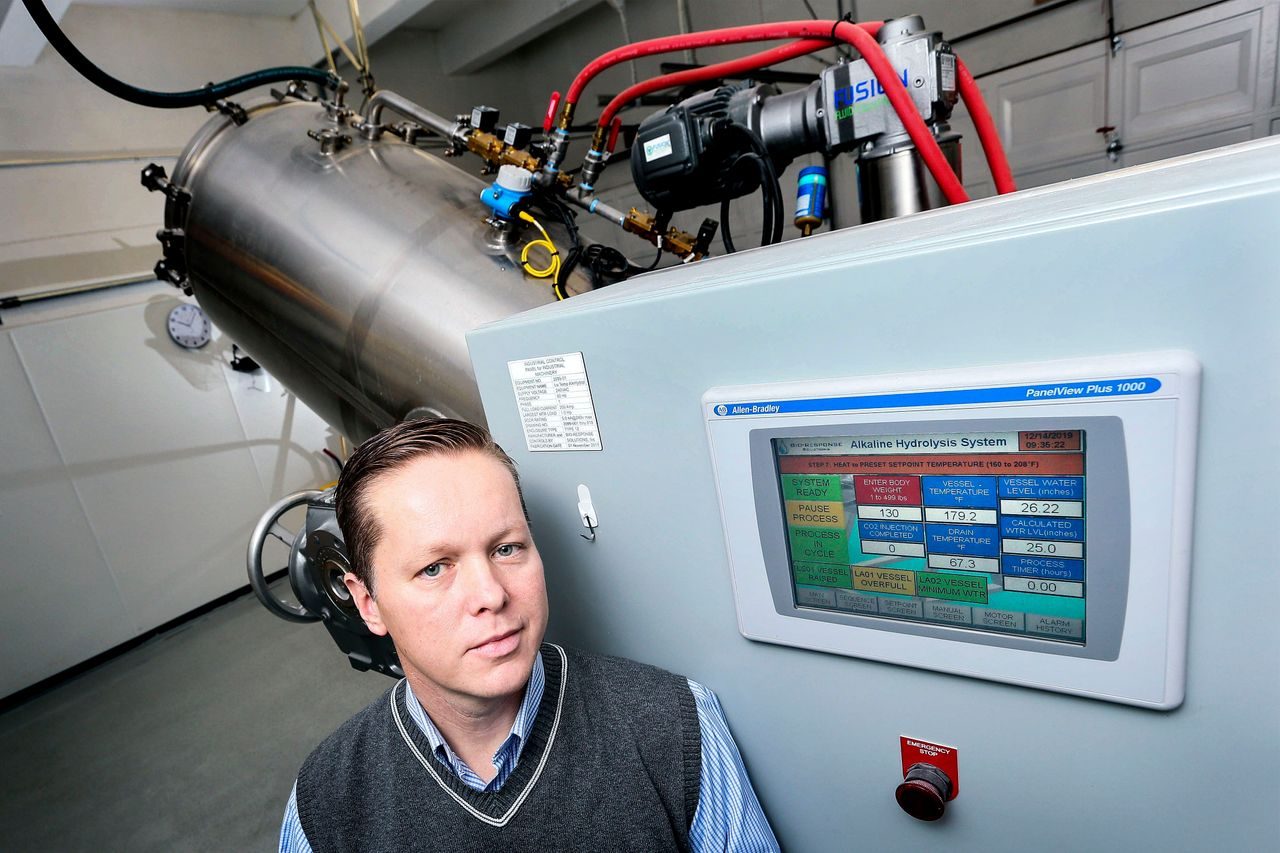 Trevor Charbonneau, a funeral home owner in Toronto, with his company's alkaline hydrolysis machine.