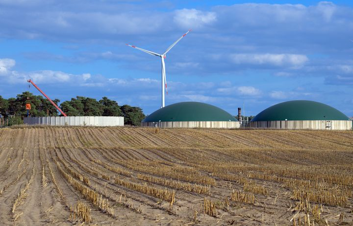A biogas plant in Brandenburg, Germany, and the corn field that fuels it.