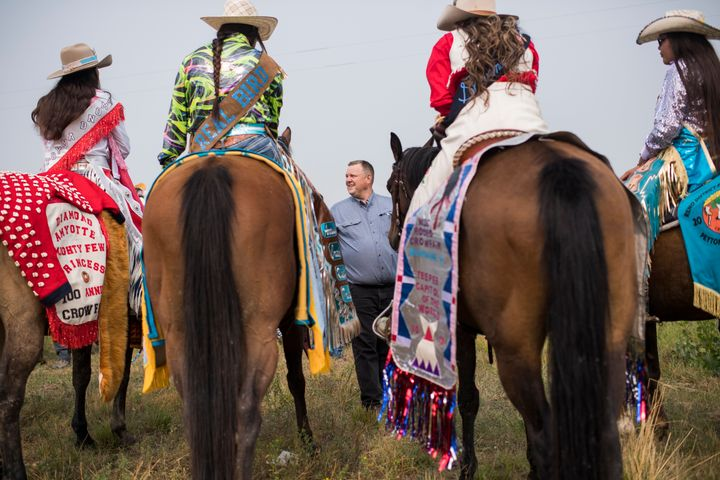 Sen. Jon Tester (D-Mont.) talks with constituents before a parade at Crow Fair in Crow Agency, Montana, on Aug. 19, 2018. Tes