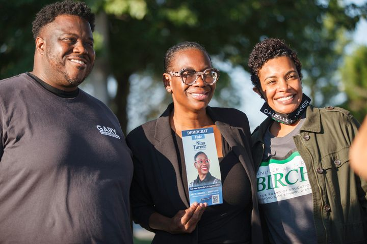 Nina Turner, center, campaigns in the Cleveland suburb of Oakwood. Politics experts believe she spent far too little of her budget on paid media and field operations.