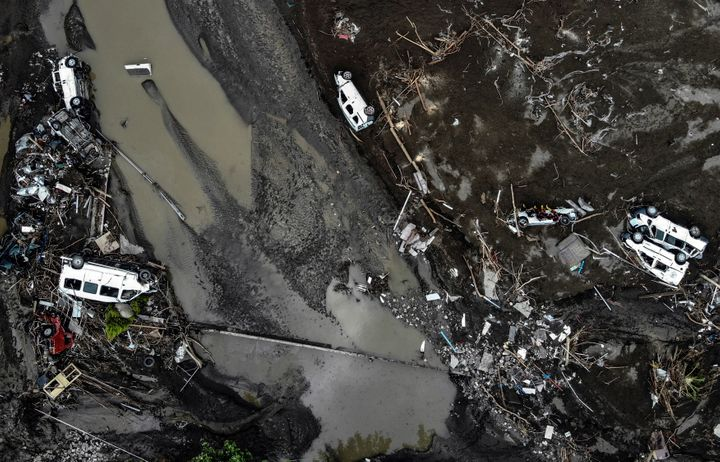 An aerial photo shows overturned cars among destruction in a mud-covered street in Bozkurt town of Kastamonu province, Turkey