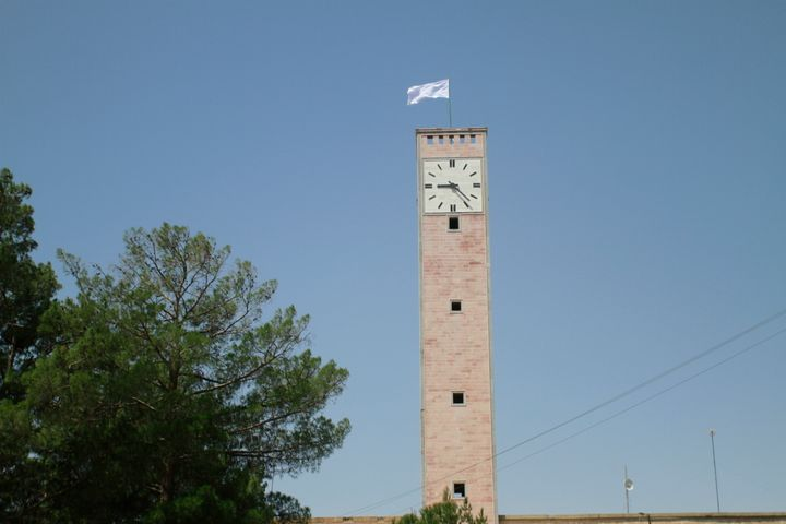 A Taliban flag flies from the clocktower of the Herat provincial official office, in Herat, Afghanistan, west of Kabul, on Sa