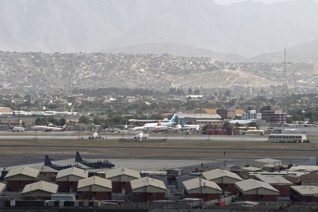 This picture taken on August 14, 2021 shows aircrafts standing on the tarmac of the airport in Kabul. (Photo by Wakil KOHSAR / AFP) (Photo by WAKIL KOHSAR/AFP via Getty Images)