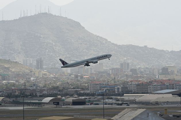 This picture taken on August 14, 2021 shows a Qatar Airways aircraft taking-off from the airport in Kabul. (Photo by Wakil KOHSAR / AFP) (Photo by WAKIL KOHSAR/AFP via Getty Images)