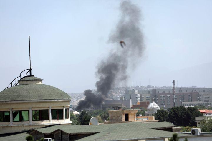Smoke rises next to the U.S. Embassy in Kabul, Afghanistan, Sunday, Aug. 15, 2021. (AP Photo/Rahmat Gul)