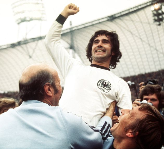 After the final whistle German forward Gerd Mueller raises his right fist in triumph. Coach Helmut Schoen joins the celebration. After numerous dramatic situations and great pressure from the Dutch team in the second half, the German team prevailed and won the World Cup final on 07 July 1974 in Munich, Germmany by a score of 2-1. Keywords: Sport, SPO, Sport, SPO, People, soccer, gesture, smiling, celebrating, cheering (Photo by /picture alliance via Getty Images)