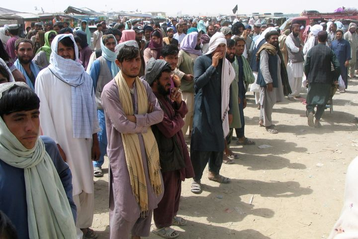 People wait to cross at the Friendship Gate crossing point at the Pakistan-Afghanistan border town of Chaman, Pakistan on Sunday.