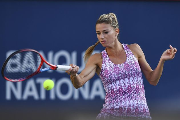 MONTREAL, QC - AUGUST 14: Camila Giorgi of Italy hits a return during her Women's Singles Semifinals match against Jessica Pegula of the United States on Day Six of the National Bank Open presented by Rogers at IGA Stadium on August 14, 2021 in Montreal, Canada. Minas Panagiotakis/Getty Images/AFP == FOR NEWSPAPERS, INTERNET, TELCOS & TELEVISION USE ONLY ==