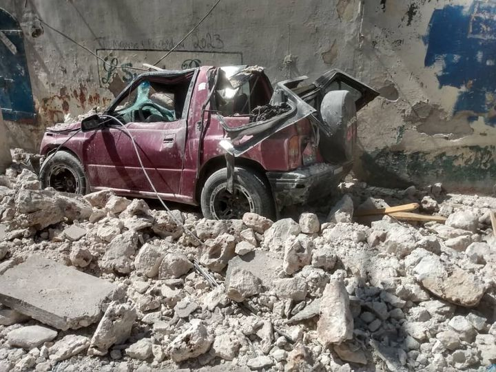 JEREMIE, HAITI - AUGUST 14: A photo shows a damaged car in the rubble after a 7.2 magnitude earthquake struck the country on August 14, 2021, in Jeremie, Haiti. The earthquake's epicenter was 12 kilometers (7.5 miles) northeast of Saint-Louis-du-Sud, with a depth of 10 kilometers (6 miles). (Photo by Stringer/Anadolu Agency via Getty Images)