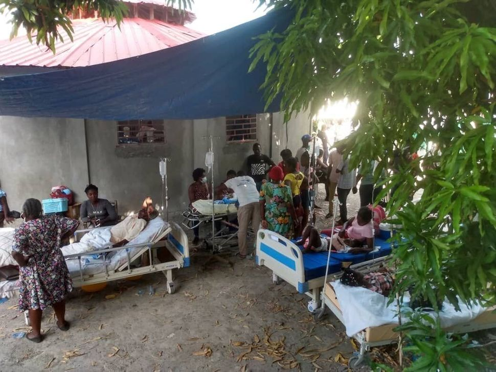 Injured people are treated in a field hospital in Jeremie, Haiti.