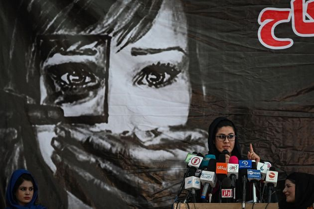 A social worker address the Afghan women gathered at a hall in Kabul on August 2, 2021 against the claimed human rights violations on women by the Taliban regime in Afghanistan. (Photo by SAJJAD HUSSAIN / AFP) (Photo by SAJJAD HUSSAIN/AFP via Getty Images)