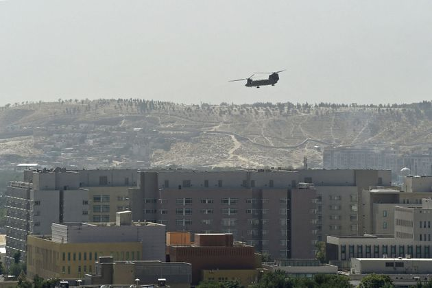 A US military helicopter is pictured flying above the US embassy in