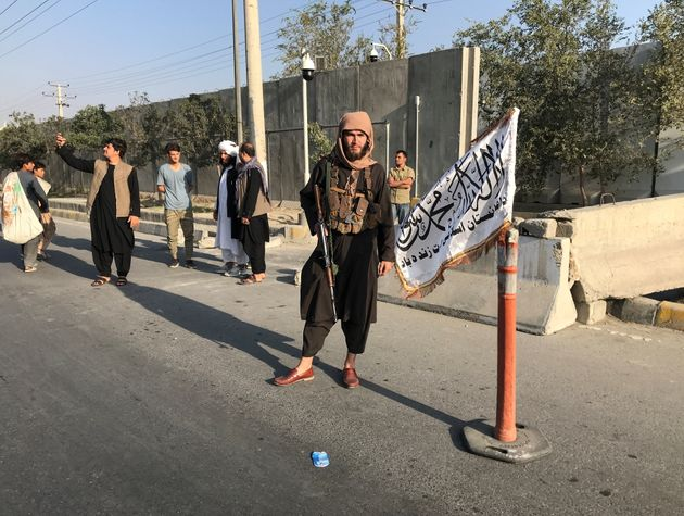A member of Taliban stands outside the Interior Ministry in
