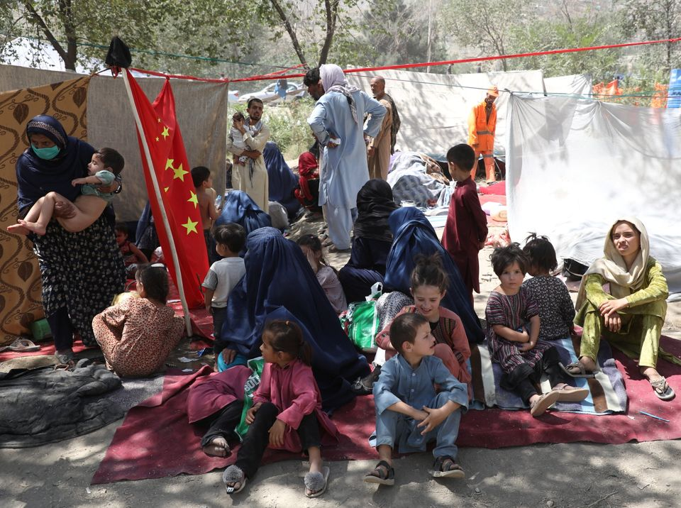 Displaced families who fled from their homes take shelter in a public park in