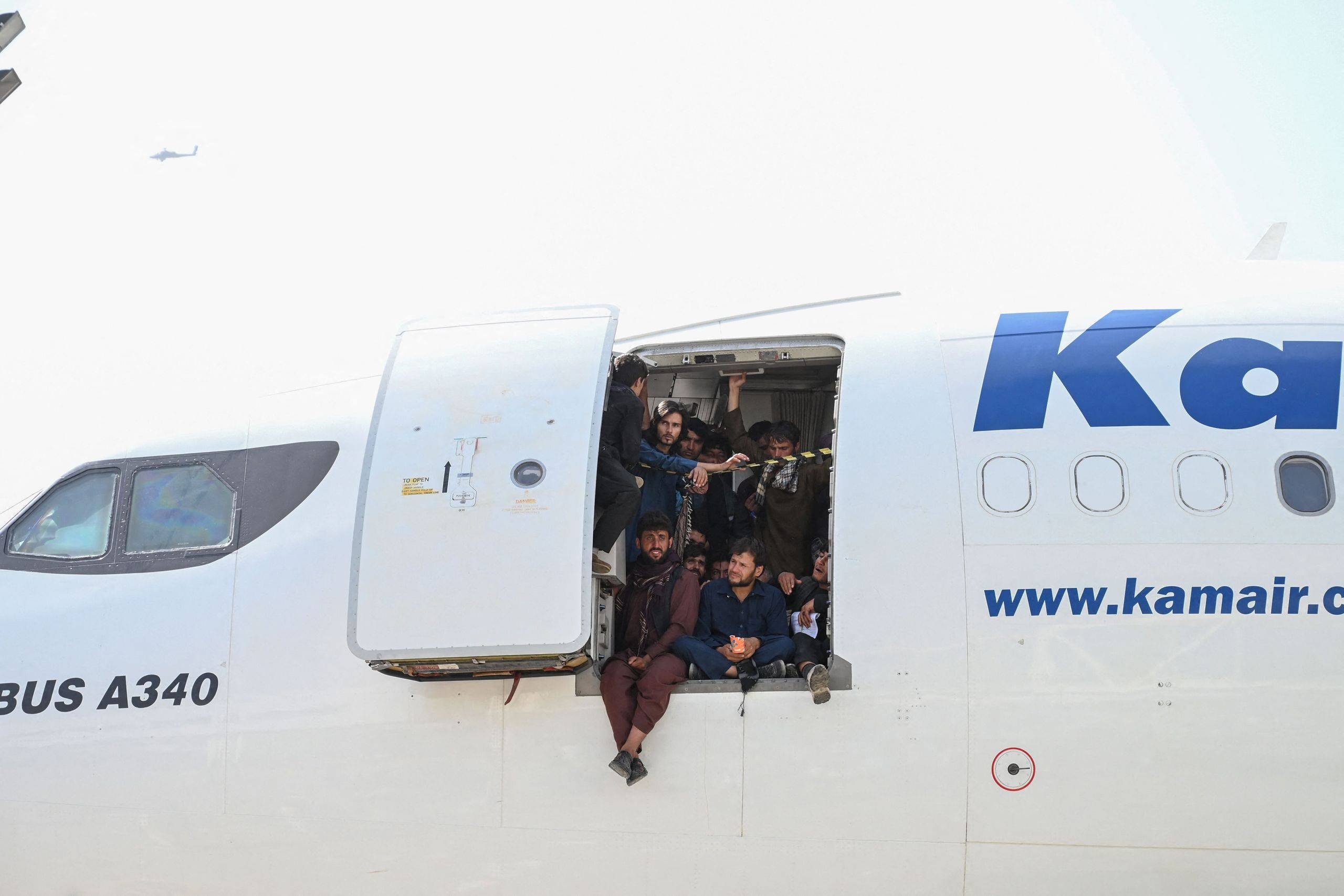Video Shows Afghans Clinging To U.S. Military Plane As It Takes Off In Kabul