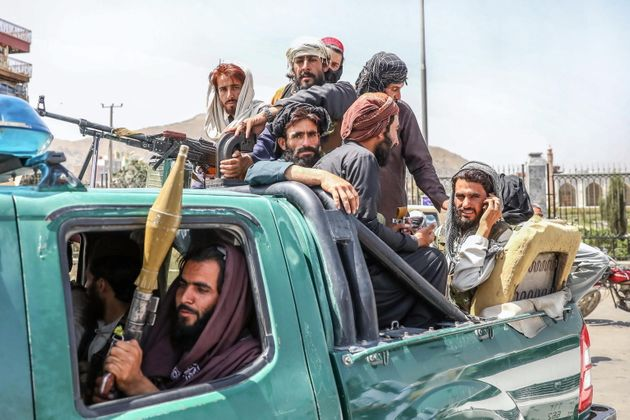 epa09416403 Taliban fighters are seen on the back of a vehicle in Kabul, Afghanistan, 16 August 2021. Taliban co-founder Abdul Ghani Baradar, on 16 August 2021, declared victory and an end to the decades-long war in Afghanistan, a day after the insurgents entered Kabul to take control of the country. Baradar, who heads the Taliban political office in Qatar, released a short video message after President Ashraf Ghani fled and conceded that the insurgents had won the 20-year war. EPA/STRINGER