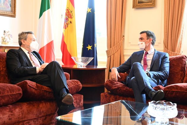 epa09283130 Italian Prime Minister Mario Draghi (L), meets his Spanish counterpart, Pedro Sanchez (R), after receiving the Catalan business association Foment del Treball's commemorative medal on the occasion of its 250th anniversary in recognition for his 'rigorous work and commitment to public service', during an event held in Barcelona, Spain, 18 June 2021. EPA/MONCLOA HANDOUT HANDOUT EDITORIAL USE ONLY/NO SALES