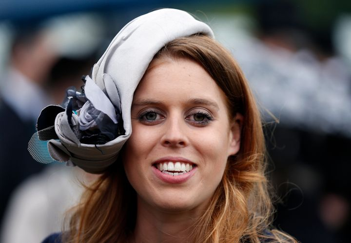 Princess Beatrice smiles during a garden party held at Buckingham Palace on May 30, 2013, in London.