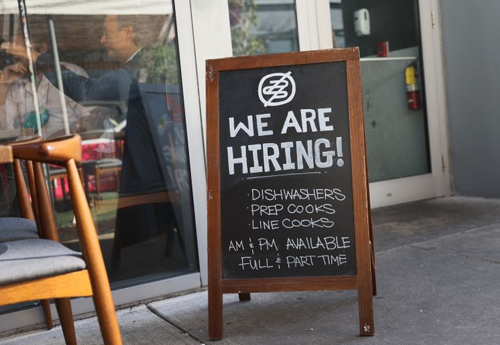 A hiring sign in front of the Buya restaurant in Miami, Florida, in March.