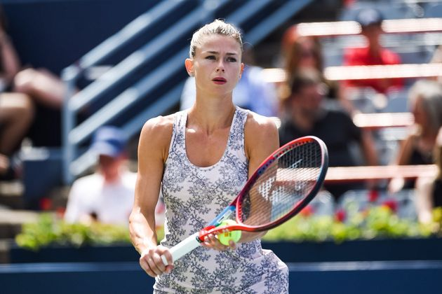 MONTREAL, QC - AUGUST 15: Camila Giorgi (ITA) returns the ball during the final WTA National Bank Open match on August 15, 2021 at IGA Stadium in Montreal, QC (Photo by David Kirouac/Icon Sportswire via Getty Images)