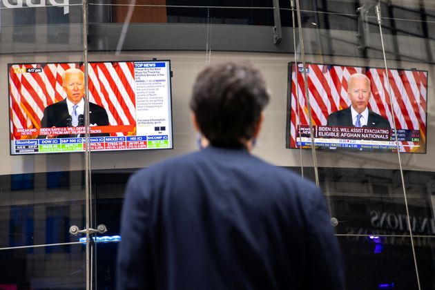 Screens display the U.S. President Joe Biden's remarks on the crisis in Afghanistan at the Nasdaq MarketSite in Times Square in New York City, U.S., August 16, 2021. REUTERS/Jeenah Moon