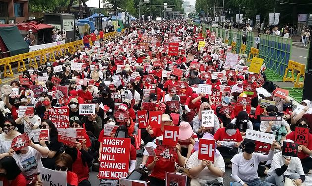 This picture taken on June 9, 2018 shows South Korean women staging a monthly protest against secretly-filmed...