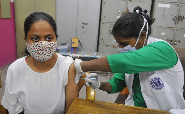 A health worker administers a dose of Covid 19 vaccine to a beneficiary, on August 16, 2021 in Chandigarh,