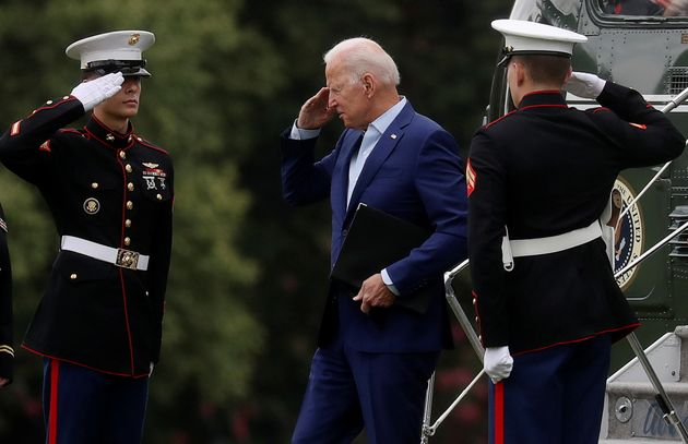 U.S. President Joe Biden returns a salute as he arrives at Fort McNair on his way back to the White House to deliver a statement on Afghanistan, in Washington, U.S., August 16, 2021. REUTERS/Leah Millis