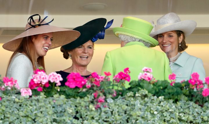 Princess Beatrice, the Duchess of York and Lady Carolyn Warren, right, speak with Queen Elizabeth II in the Royal Box before watching the Queen's horse Elector run on Day 4 of the Royal Ascot on June 22, 2018.