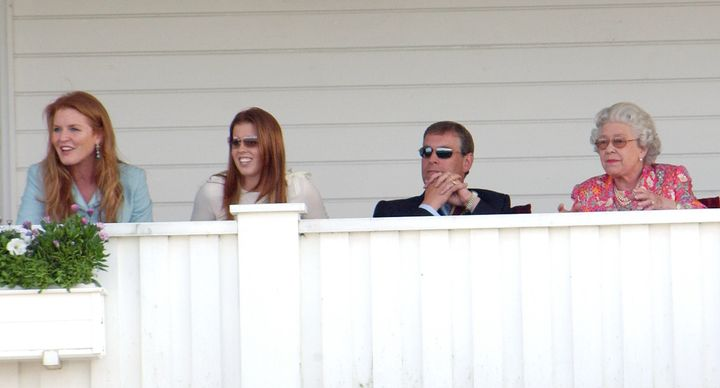The Duke and Duchess of York, their daughter Princess Beatrice, and Queen Elizabeth attend the Queen's Cup polo match in Windsor in 2004.