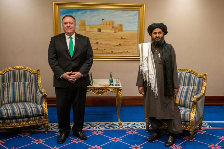 """U.S. Secretary of State Mike Pompeo meets with the Taliban political affairs chief Mullah Abdul Ghani Baradar in Doha, Qatar, on Sept. 12, 2020. Pompeo recently said that the Biden administration had """"failed"""" on Afghanistan."""