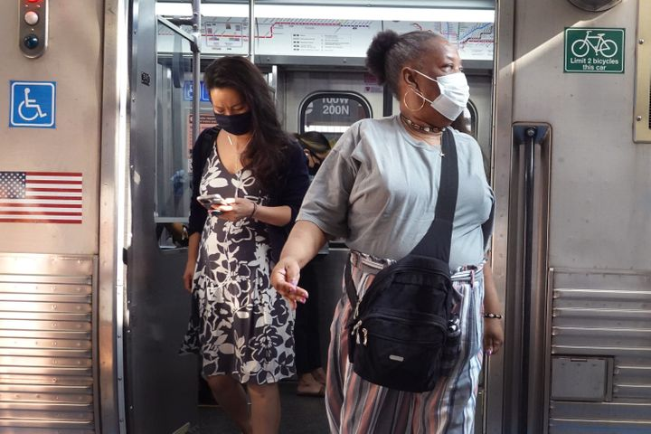 Chicago commuters wear face masks on July 27, 2021. The Centers for Disease Control and Prevention recommends that fully vaccinated people wear face masks indoors again in places with high COVID-19 transmission rates.