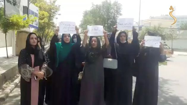 A group of women hold a street protest calling on the Taliban to protect their rights, in Kabul, Afghanistan August 17, 2021 in this still image taken from video dated August 17, 2021. Shamshad News/via REUTERS THIS IMAGE HAS BEEN SUPPLIED BY A THIRD PARTY. MANDATORY CREDIT. MUST NOT OBSCURE LOGO
