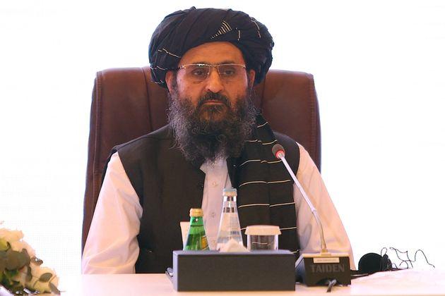 The leader of the Taliban negotiating team Mullah Abdul Ghani Baradar looks on the final declaration...