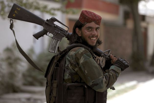 A Taliban fighter patrols in Wazir Akbar Khan in the city of Kabul, Afghanistan, Wednesday, Aug. 18, 2021. The Taliban declared an