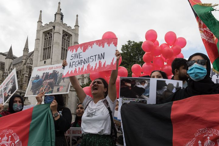Demonstrators protest in Parliament Square against Taliban and demand human rights in Afghanistan as MPs hold a debate on the crisis.