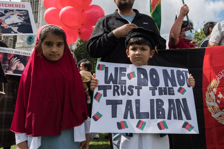 Children demonstrating in Parliament Square as MPs hold a debate on the crisis in Afghanistan.